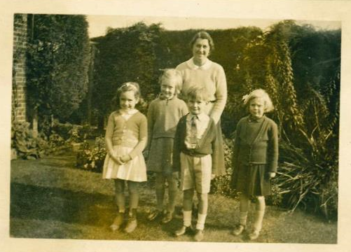 Miss Phyllis Burden and the first pupils : Joanna, Jill, Humphrey and Belinda